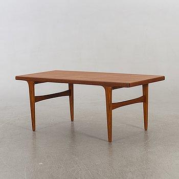 A teak mid 20th century sofa table.