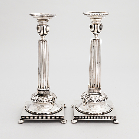 A pair of swedish silver candlesticks, cg hallberg, stockholm 1901 and 1902.