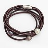 Schoeffel, a leather bracelet with cultured pearls.