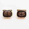 A pair of 14k gold cufflinks with smoaky quartzes. nummilan koru, turku 1971.