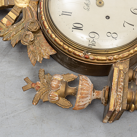 A late gustavian wall clock signed g.a berg, stockholm.