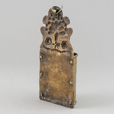 A 17th century brass spoon holder.