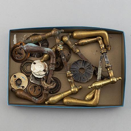 Seven brass door handles, 19th/20th century.