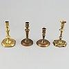 Four 18th century bronze candlesticks.