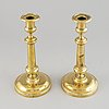 A pair of bronze empire candlesticks, first half of he 20th century.