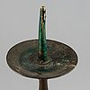 A 17th century bronze candlestick.
