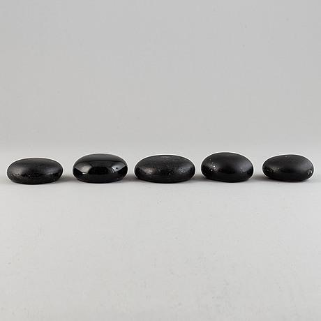 Five glass ironing stones, 18th/19th century.