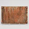 """An iron sign,  """"atlas stockholm 1913""""."""