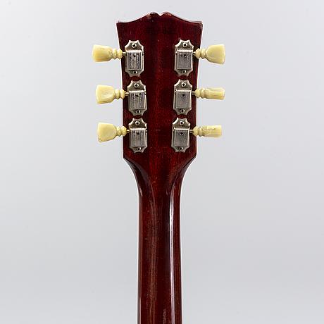 An electrical guitar, gibson sg standard.