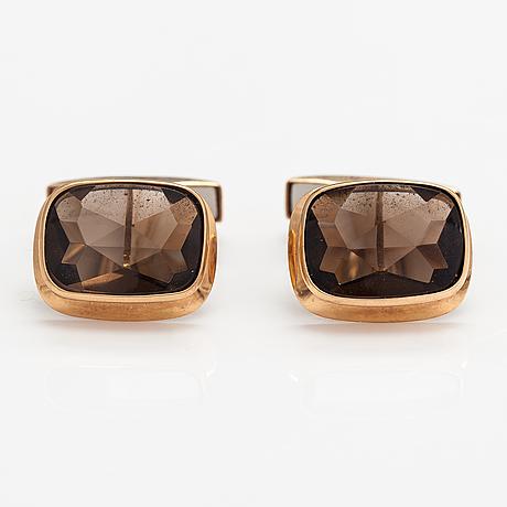 A pair of 14k gold cufflinks with smoaky quartzes. liitola & koistinen kultasepät, turku 1977.