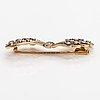 An 18k gold brooch with 8/8-cut diamonds ca. 0.68 ct in total. oskar lindroos, helsinki 1953.