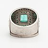 A platinum ring with emeralds and diamonds ca. 0.21 ct in total. torbjörn tillander, helsinki 1981.