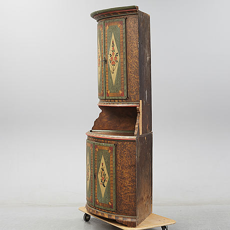 A painted pine cabient, dated 1853.