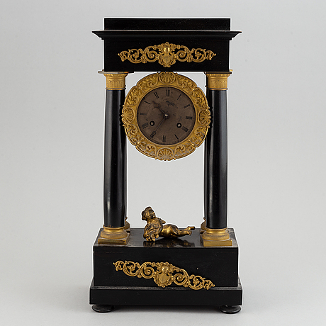 A late empire´table clock.