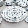A set of 75 pieces royal copenhagen blue fluted half-lace porcelain.