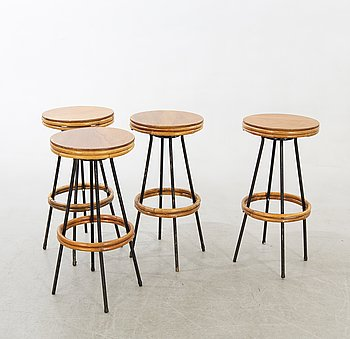 A set of four mid 20th century bar stools.