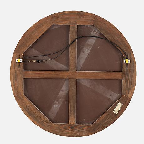A round mirror. 1930's.