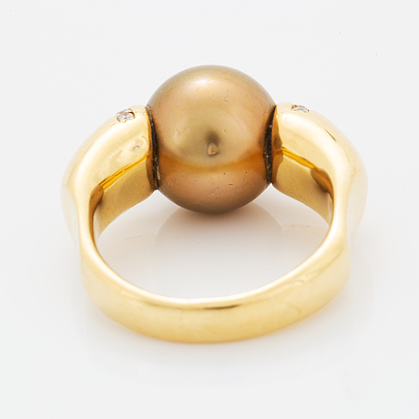 Cultured south sea pearl and diamond ring.