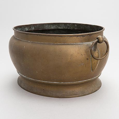 A 19th century brass wine cooler.