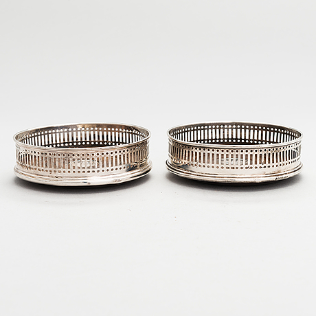 A pair of sterling silver coasters, carrs, sheffield 1995.