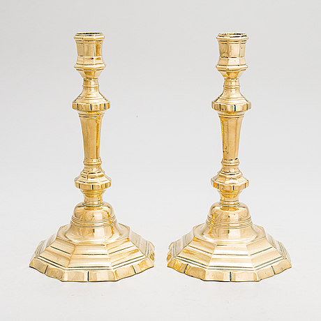 A pair of mid 18th century brass, argent haché, candlesticks.