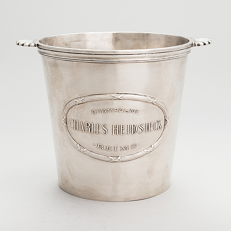 A silver plated brass charles heidsieck champagne cooler.