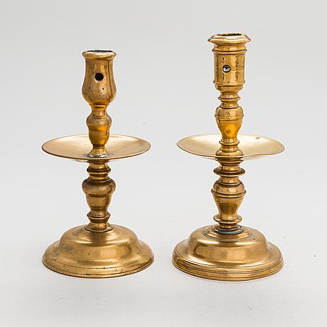 Two 17th-century flemish bronze candlesticks.