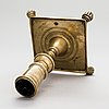 A late 17th century spanish brass candlestick.