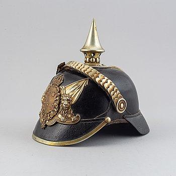 A Swedish spiked helmet 1887 pattern.