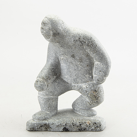 A simon kristofferson signed stone figurine.