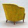 A mid-20th-century armchair.