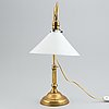 An early 20th century brass table lamp.