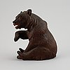 "A carved wooden sculpture of a ""black forest bear"" from around the year 1900."