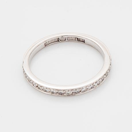 Brilliant-cut diamond eternity ring.