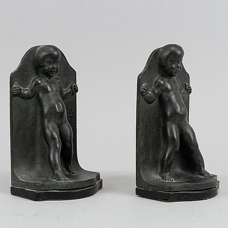 Axel gute, a pair of green patinated metal bookends, sweden, dated 1920.