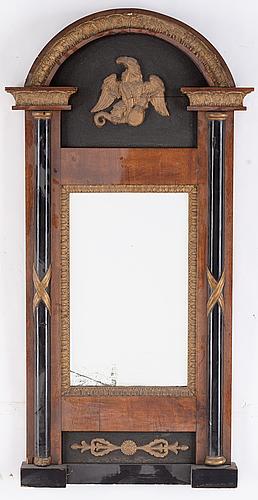 An empire style mirror, 19th century.