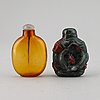 Two chinese snuff bottles with stoppers.