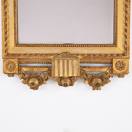 A signed gustavian mirror dated 1785.