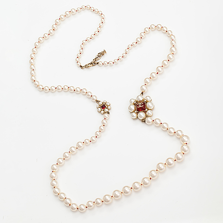 Chanel, a pearl collier with plastic pearls, glass stones and gold coloured metal parts. marked chanel, made in france.