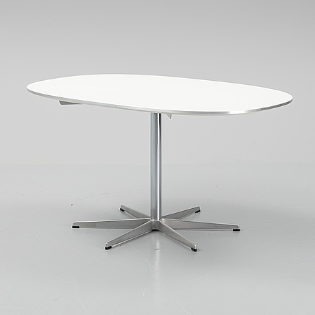 An arne jacobsen table for fritz hansen, signed with label and dated 1985.