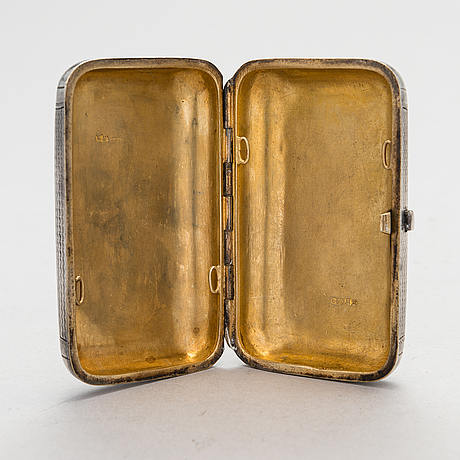 A russian, parcel-gilt silver cigarette case, maker's mark of karl verlin, saint petersburg 1871-1878.