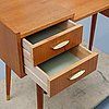 A teak makeup-table from the mid 20th century.
