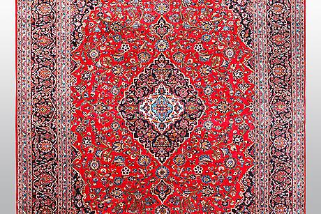 A carpet, kashan, ca 384 x 295 cm.