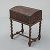 A late 18th or early 19th century wooden box on a stand from early 20th century.