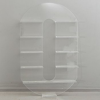 Shelf, plexi glass, in the shape of the letter 'O',Non Violence.