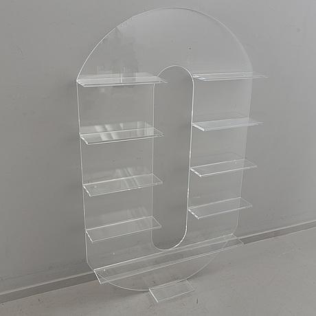 Shelf, plexi glass, in the shape of the letter 'o',non violence.