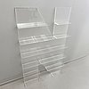 Shelf, plexi glass, in the shape of the letter 'n', non violence.