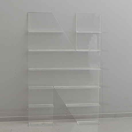 Shelf, plexi glass, in the shape of the letter 'n',non violence.