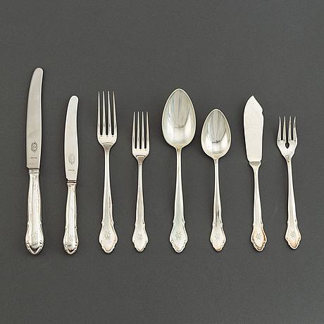 A silver cutlery, k anderson, some 1928, (95 pieces).