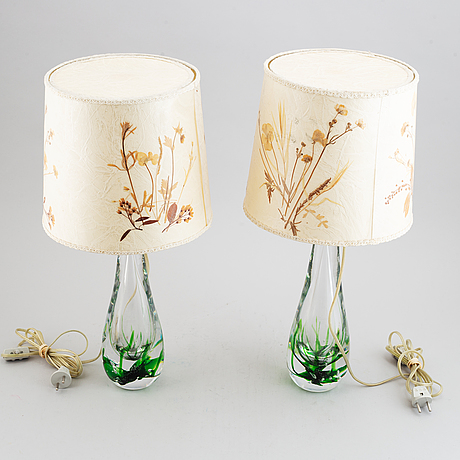 A pair of glass table lamps, vicke lindstrand, kosta, signed.